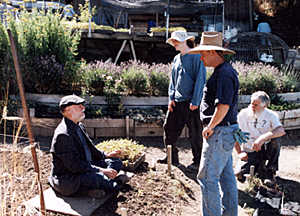 John Jeavons teaching about transplanting at the 5-day Teacher Certification Workshop in July, 1999.